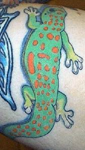 Green dotted amphibia tattoo
