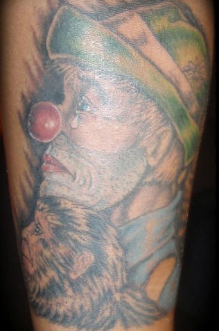 Sad hobo clown with monkey tattoo
