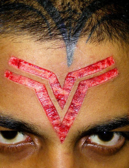 Skin scarification symbol on forehead