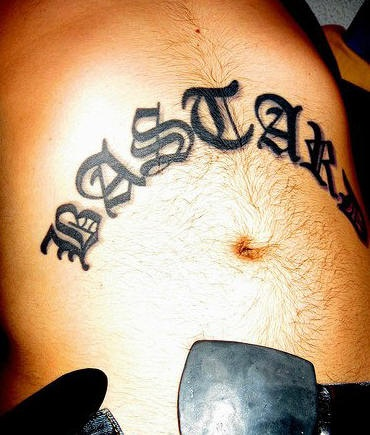 Script stomach tattoo, black,styled  inscription