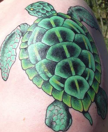 Bright green sea turtle tattoo