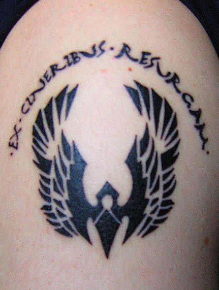 Shoulder tattoo, sign of devil and inscription