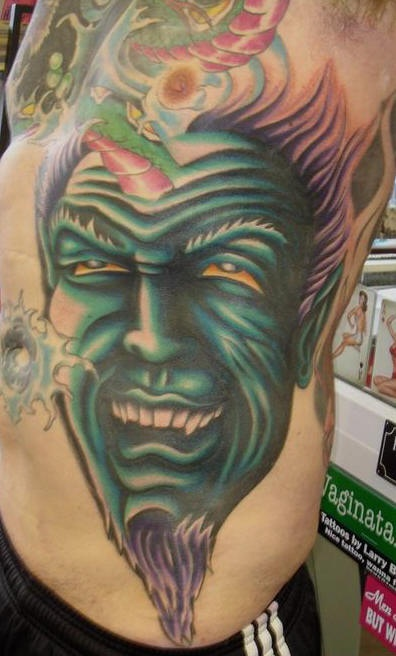Side tattoo, green, dreadful, laughing, horned  monster