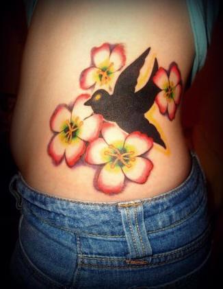 Side tattoo, black, contrast swallow flying near flowers
