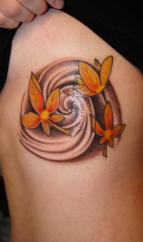 Side tattoo, orange leaves turning in circulation