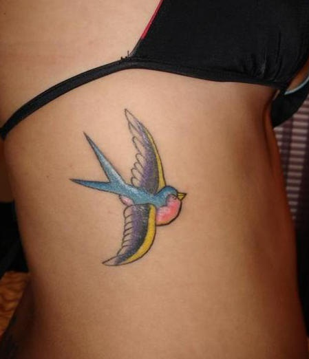 Side tattoo, little, nice, colourful swallow flying