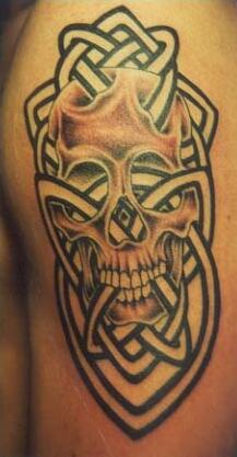 Skull with tribal tracery tattoo