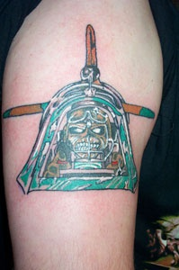 Skull on battle plane coloured tattoo