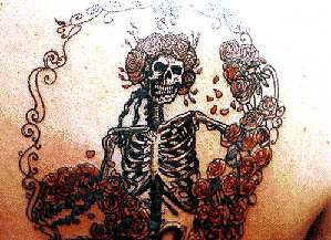 Amazing skeleton in roses tattoo