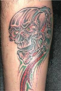 Biomech skull coloured tattoo