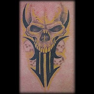 Tribal demon skull tattoo