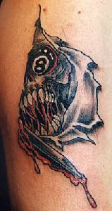Skull with eight ball eye tattoo