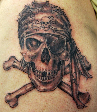 Realistic pirate skull and crossbones tattoo