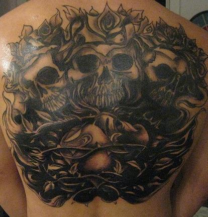 Dark black skulls and roses vine tattoo on back
