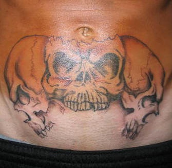 Stomach tattoo, three,black and white, teethy skulls