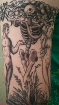 Skeleton tree with adam and eve tattoo