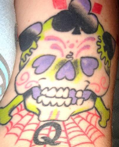 Sugar skull with suites tattoo