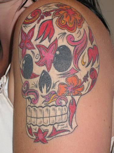 Sugar skull in flower pattern tattoo