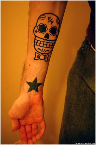 Sugar skull with bow tie tattoo