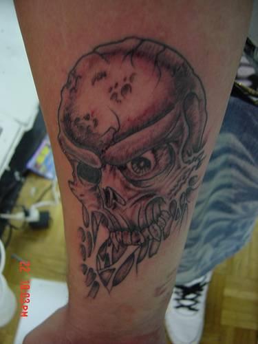 Evil crushed skull tattoo