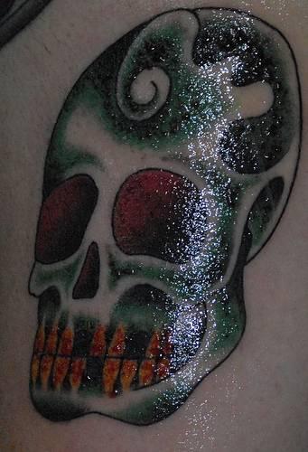 Dark-green sugar skull tattoo
