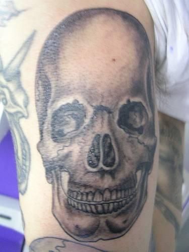 Realistic human skull tattoo