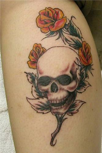 Human skull with yellow roses  tattoo