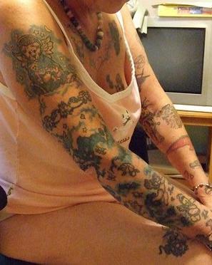 Cherub themed full sleeve tattoo