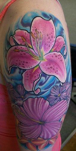 Colourful purple flowers tattoo