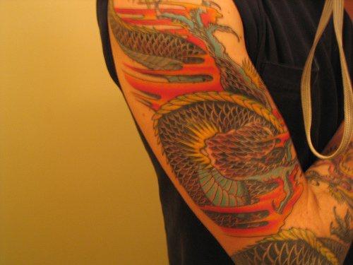 Asian dragon sleeve tattoo