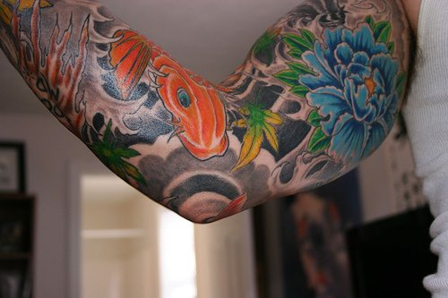 Asian style sleeve tattoo with blue flower and koi fish