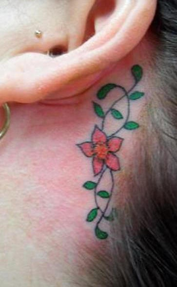 Coloured flower tracery tattoo behind ear