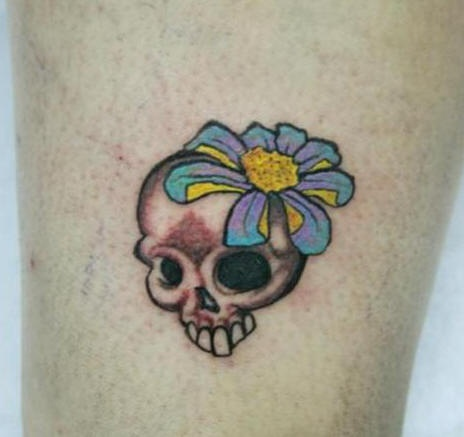 Coloured skull with flower tattoo