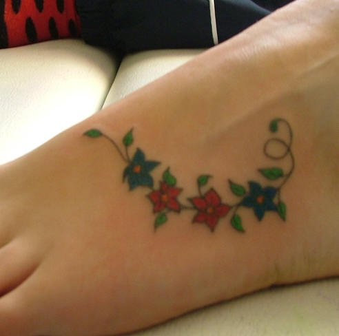 Coloured flower tracery tattoo on foot
