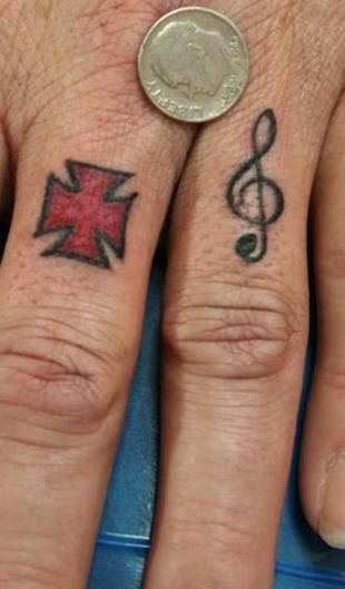 Maltese cross and musical note tattoo