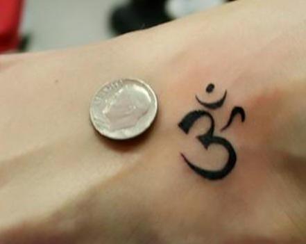 Small aum symbol tattoo