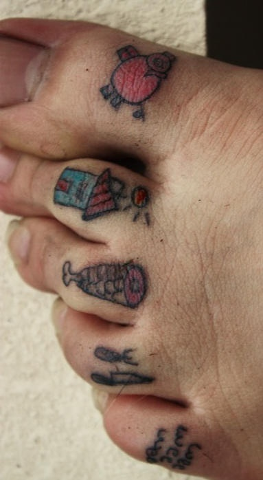 Small primitive toe tattoos