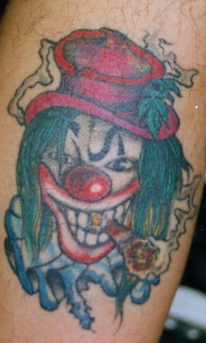Clown smoking joints tattoo