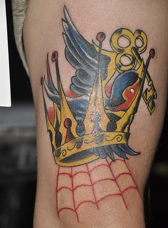 Sparrow with key and crown tattoo