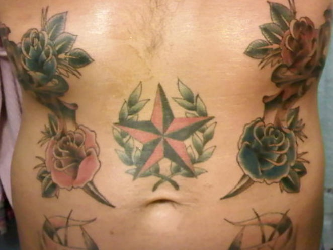 Stomach tattoo, star designed  and many roses