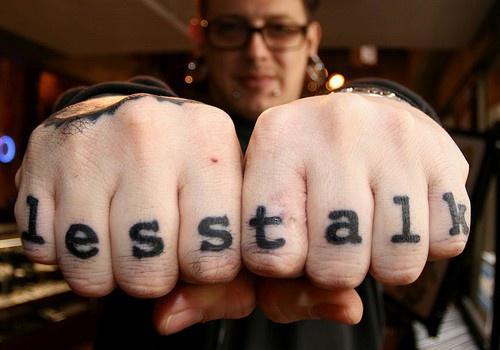 Less talk, black inscription, fingers  star hand tattoo