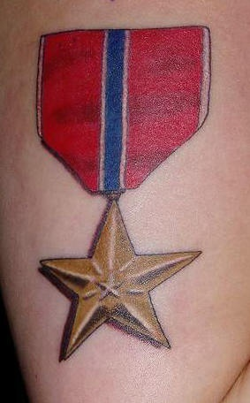 Star medal tattoo in colour