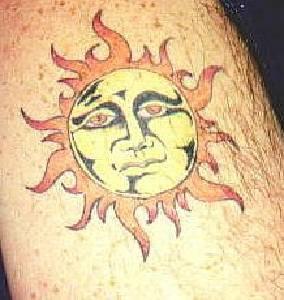 Humanized sun coloured tattoo
