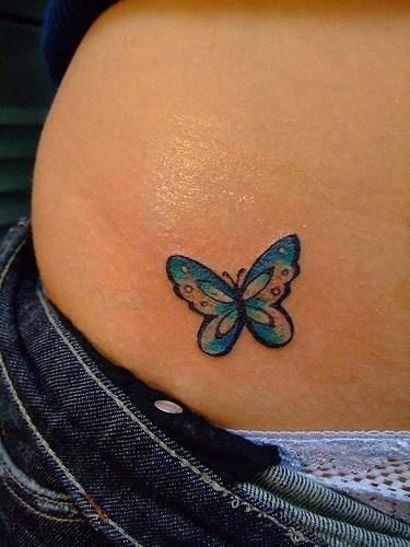 Blue, little, beautiful , butterfly star tattoo on hip