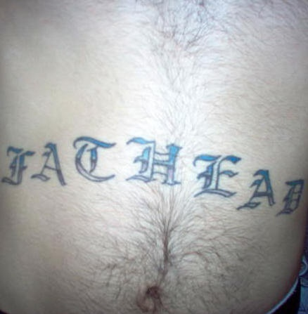 Stomach tattoo, designed letters, wide inscription