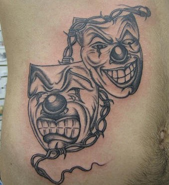 Stomach tattoo, crying in despair and laughing masks