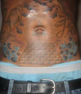 Stomach tattoo, shining triangle with one eye