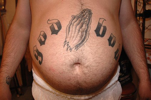 Stomach tattoo, god,styled inscription praying hands