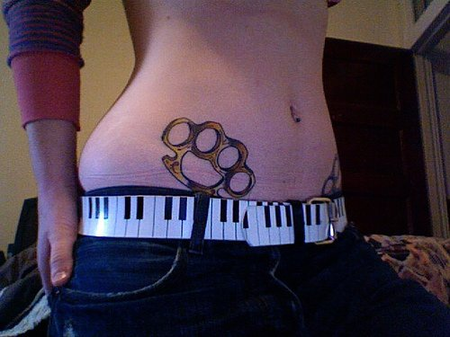 Stomach tattoo,gold, designed  knuckles
