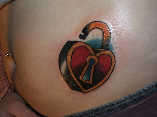 Stomach tattoo,catching heart-lock, opened